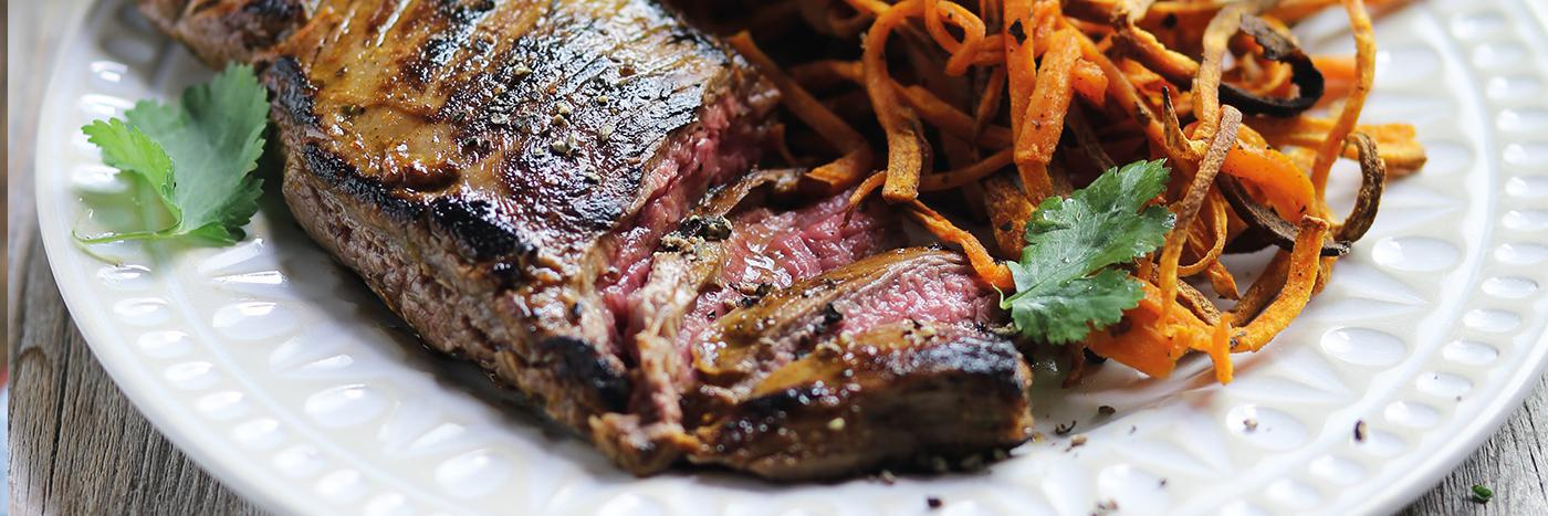 Mojo bavette steaks with spicy shoestring fries & mango salad